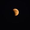 Eclipse just beginning. Moon near horizon, thus a bit yellow.