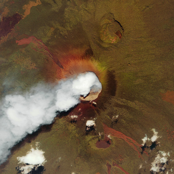 Steam and smoke pours from the crater of the East African volcano Nyiragongo. The volcano is in the extreme eastern edge of the Democratic Republic of Congo near the border with Rwanda in the African Rift Valley. This orbital view was taken by the Ikonos satellite. --- Image by © NASA - digital version copyright/Science Faction/Corbis