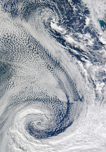 """29 Apr 2009 --- It took the Moderate Resolution Imaging Spectroradiometer (MODIS) on NASA's Terra satellite a full five minutes to fly over this expansive cloud pattern on April 29, 2009. The sprawling """"S""""-shaped swirl is actually two cyclones that seem to be feeding on each other. Polar cyclones often form as a result of low-pressure systems over the ocean, and usually bring winds and heavy snow. Jeff Schmaltz, MODIS Land Rapid Response Team, NASA GSFC --- Image by © NASA/Corbis"""