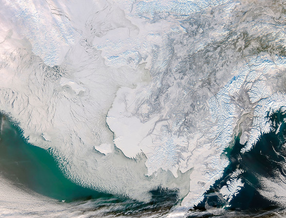 Sea ice clogs the Bering Strait beside a snow-covered Alaska. Phytoplankton bloom green south of the ice. On land, the twisted braid of the Yukon River flows from the upper right to the outline of branches of the Yukon Delta near the center. The image was made by the MODIS (Moderate Resolution Imaging Spectroradiometer) on NASA's Aqua satellite. Image Credit: Jeff Schmaltz, GSFC, NASA. --- Image by © NASA - digital version copyright/Science Faction/Corbis