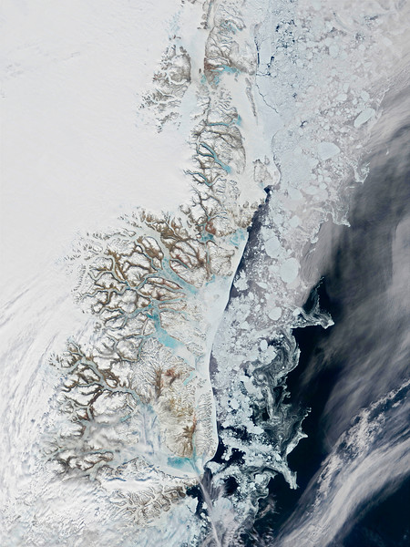 Sea ice is pulling back from the east coast of Greenland, and the numerous fjords that cut into the coastline are showing blue water through the ice that chokes them. Later in the summer, the ice will be gone for a brief time before the return of winter. The climate of the region is arctic to subarctic, with cool summers and cold winters. Taken by NASA's Moderate Resolution Imaging Spectroradiometer, or MODIS. --- Image by © NASA-GSFC - digital version copy/Science Faction/Corbis