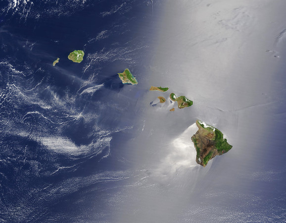 27 May 2003 --- True-color MODIS image from the Terra satellite, acquired on May 27, 2003, of the Hawaiian islands. From lower right to upper left, the Big Island of Hawaii, Maui, Kahoolawe, Lanai, Molokai, Oahu, Kauai, and Niihau which make up the state of Hawaii. Winds ruffling the water surface around the Hawaiian Islands creating varying patterns, leaving some areas calmer than others. Southwest of Hawaii and Maui, on their leeward sides, calmer waters are indicated by brighter silver coloration. Conversely, notice how most of the vegetation on the Hawaiian Islands grows on their northeastern, or windward, sides. --- Image by © NASA/Corbis