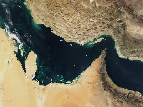 30 Dec 2001, Iran --- MODIS image illustrating the plate tectonics of the Persian Gulf where the younger Arabian plate (lower left) is running up on the Eurasian plate (upper right). The Persian Gulf (top) and the Gulf of Oman (bottom) were once the site of a rift, where the two plates pulled apart from each other, and the Indian Ocean filled in the widening gap between the plates. The process then reversed, and about 20 million years ago, the gulf began to close up. The collision of the two continental plates gives Iran its mountainous terrain. --- Image by © NASA/Corbis