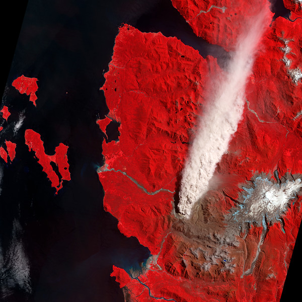 19 Jan 2009 --- False color image using visible and infrared light of the Chaiten Volcano and surrounding area captured by the Advanced Spaceborne Thermal Emission and Reflection Radiometer (ASTER) on NASA's Terra satellite. Vegetation is red while bare (possibly ash-covered) ground is brown and water is deep blue. The plume from the volcano appears off-white and is thick enough to completely hide the land surface below. --- Image by © NASA/Corbis