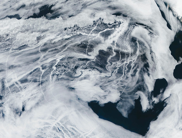 """29 Apr 2002 --- Pacific Ocean """"ship tracks"""" produced by sulfate aerosols released by large ships. Terra, April 29, 2002 --- Image by © Jacques Descloitres, MODIS/NASA/Michael Benson/Kinetikon Pictures/Corbis"""