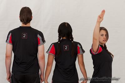 Katniss salutes.