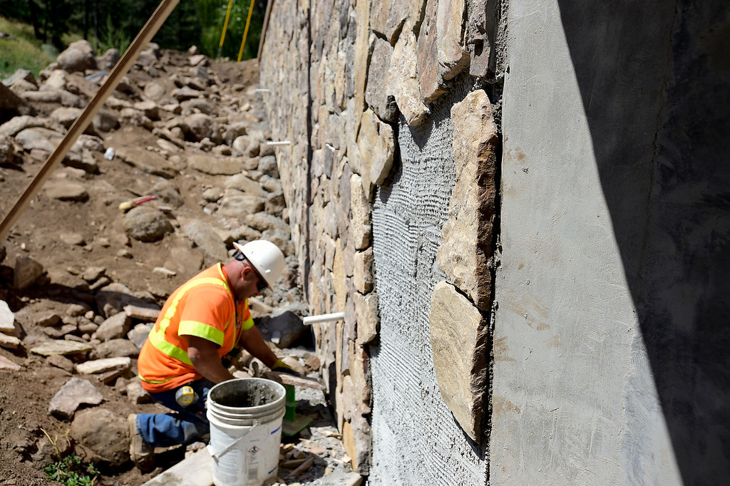 . BOULDER COUNTY, CO - AUGUST 9: Stone Mason Volodymyr Narolskyy, with G&E Construction, installs a stone facade to a culvert near Wagon Wheel Drive in Boulder County on Aug. 9, 2018. The original culvert was destroyed during the 2013 flood. (Photo by Matthew Jonas/Staff Photographer)