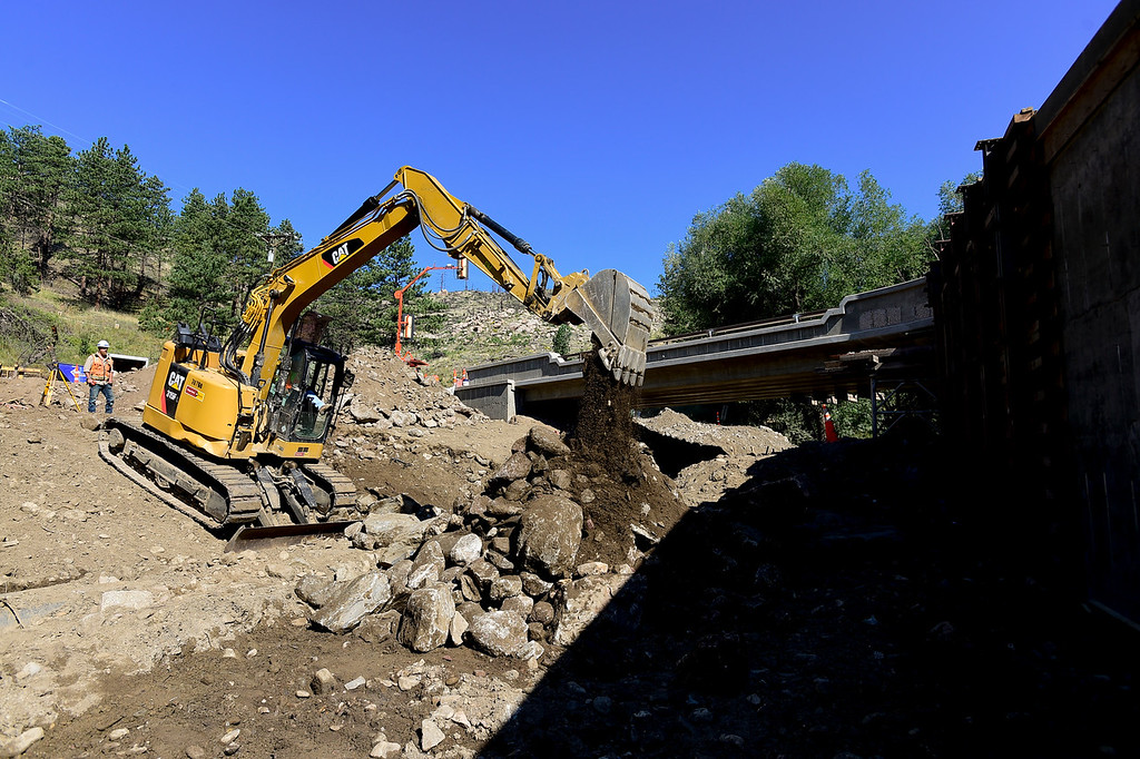 . BOULDER COUNTY, CO - AUGUST 9: Dirt and rocks are removed before a cistern is installed near Logan Mill Road and Fourmile Canyon Drive in Boulder County on Aug. 9, 2018. The intersection and surrounding area sustained significant damage in the 2013 flood. (Photo by Matthew Jonas/Staff Photographer)