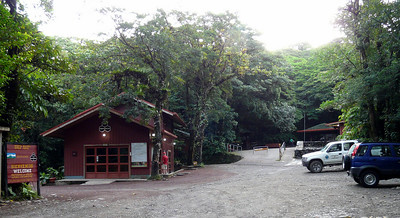 Here we are arriving at Monteverde Reserve, 5:30 AM, looking for the Resplendent Quetzals that are seen early AM's in the parking lot sometimes. Our blue rental on the right. Mark peering in the windows at the office. Alas no quetzals and no one there at all, just a park truck and us.