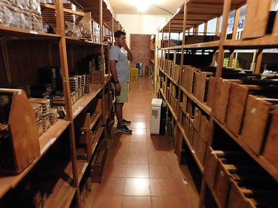 Touring Tobacos de Costa Rica. Andres, the production manager and son of the founder shows us the ageing room where cigars are stored to allow the flavors to mellow and meld together before the cigars are ready to sell.