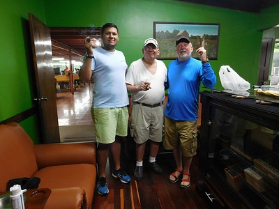 Touring Tobacos de Costa Rica. End of the tour! Cigar time! Andres, the production manager, with Chris and his dad.