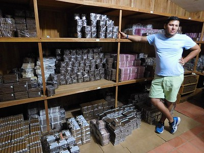 Touring Tobacos de Costa Rica. This cigar factory is just 30 minutes from Chris' dad's house. This is Andres showing  just part of the room filled with finished cigars for sale.