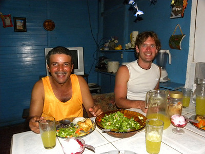 Tim and our host enjoying a meal together.