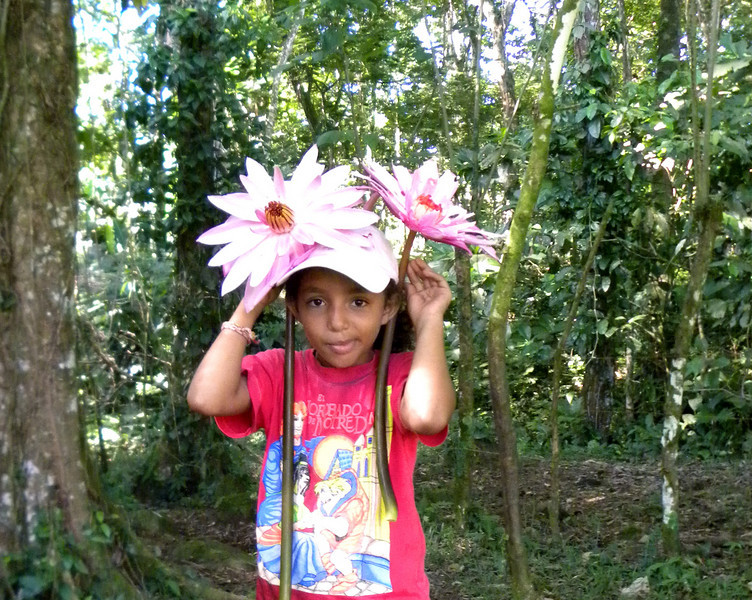 Flower child...Maria Jose with pond lilies.