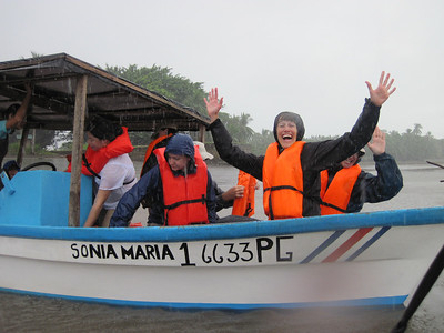 Stacia P and Cindy H's spirits are not dampened by a little rain in Osa. Photo by A.M. Burgamy