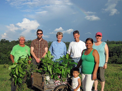 """""""el arco iris"""" We learn the term for rainbow at our home stay on Los Laureles Farm (note upper right corner). L-R Don Fernando, Mark W., Cindy S., Steve B., Aimee B., Donna Lydia, and little Sebastian. Photo by A.M. Burgamy"""
