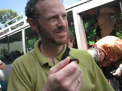 Todd P. finds a centipede at the Earth University banana field. Photo by A.M. Burgamy