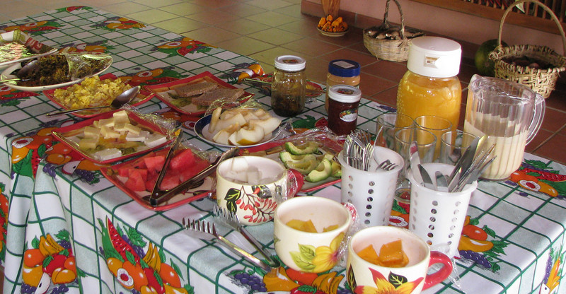 Finca Luna Nueva - Breakfast Is Served - Notice The White Pineapple In Third Mug Of Fruit