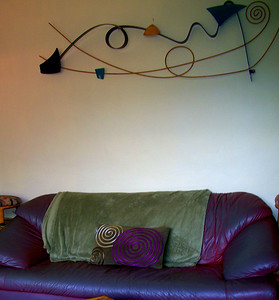 Note the Wall Art, pillow & blanket are NOT included & they may have a different sofa there now.