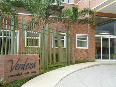 WHERE:  ESCAZU (Trejos Montelegre) VERDEZA SENIOR LIVING COMMUNITY  Verdeza.com/en/index.php  •  facebook.com/pages/Verdeza/148766311938021   (4-031-0781 if you get lost)  FROM SAN JOSE:  •  Take Highway 27•Pista del Sol towards Escazú  •  Get off at the FIRST Escazú exit (at WalMart) & immediately get in the right lane.  •  At the stop light, turn RIGHT (Walmart on your right) - going West  •  Go down 800 meters•8 blocks•1km West of Walmart to Verdeza - which is on your RIGHT side (almost to the end of the street).  There is plenty of parking on the street or in their garage.    FROM THE WEST:  •  Take Highway 27•Pista del Sol (highway from the Pacific) East towards Escazú  •  Pass Price Smart & CIMA & just before the Escazú toll booth get all the way to the right (as far right as you can get depending on if you're cash or have the pass)  •  Take the FIRST Exit (the one for EPA [just BEFORE the final Escazu exit that's at WalMart]) that is JUST after the toll booth  •  Turn RIGHT.    •  At the end of that block turn RIGHT.  •  Go down 7 blocks till you see Verdeza on your RIGHT (almost to the end of the street)  There is plenty of parking on the street or in their garage.