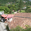 "DIRECTIONS to Hotel Pico Blanco - San Antonio de ESCAZU : DIRECTIONS - PICO BLANCO Get off Pista del Sol at the WalMart exit (if coming from San Jose – it's the first exit.  If coming from the West - East-bound – it's the 2nd exit after the toll plaza – the exit at the back of WalMart).  Go straight up that street – passing 3 lights (1st light – where you'd turn into Walmart/Tony Romas.  2nd light – just past TGIF/Chocolate___.  3rd light – just after McDonald's/KFC).  At the 4th light – the ""Scotia Split""/Cruz"" (at Scotia Bank/Banco) you want to stay in the left lane – going straight up the hill.  Pass Plaza Atlantis/Automercado (on the left) & El Novillo Allegre (on the right).  At ChiChi's Bar - TURN LEFT. (it's a small one-way street running behind Riverside Condominiums - sort of hidden behind a big tree - on your Left so keep your eyes open)  Go up to the end of that block (1 block) & at the stop sign where you must turn left or right & TURN LEFT.  Then IMMEDIATELY - TURN RIGHT - & go up the street (look for/follow the signs).  Go up – up – up the road till you come to a split in the road to the big green wall (on your left) – TURN LEFT there & follow that street – up – up – up.  When you come to the stop sign (in front of you will be a sign for the Recycle center [in Spanish]) – TURN LEFT.  Cross over the little bridge one block to the end & TURN RIGHT (there will be signs here saying ""Hotel [or Mirador] Pico Blanco"" guiding you there).  Go up – up – up the mountain till you see the signs with an arrow saying ""Hotel Pico Blanco"" & turn LEFT into the driveway.  Follow the BAD driveway up the hill towards the hotel – first it veers to the right, then veers to the left & keep going up towards the hotel.  On your left you'll first see a 2-story white apartment building with a 2-car open carport, then a sign that says ""Hotel Pico Blanco"" & an open iron gate & then another 2-car open carport & a big black garage door.   If I'm coming up to you, call me when you're getting close – or at least entering the property since I have a 2-? flights of stairs to walk my big body up!!!  If you're just meeting me/picking me up, pull in & wait for me there as it's in the garage.       Please call me when you're near the recycle plant so I can walk up to meet you as I'm a 2-1/2 flight walk up stairs!   8-378-6679  See you soon!!   Vicki   Continue up the hill to the hotel & park there!"