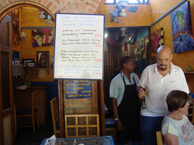 Owner Bill & the great server Watson!  CAFE DES ARTISTAS  (http://cafe-de-artistas.com / 2-288-5082).    AWESOME place for BREAKFAST!! EGGS BENEDICT, U.S. style homemade CINNAMON ROLLS. WONDERFUL FUNKY/COOL/ARTSY AMBIANCE!  Watson's the sweetie to take care of you (in English!!). LIVE MUSIC - JAZZ BRUNCH usually the 2nd or 3rd Sun. of month - 11am-1pm-ish.  HOLIDAYS:  They are open most holidays. OWNER:  Bill Hill  billhill98290@yahoo.com   HOURS: Mon. -Sat. 8am-6pm & Sun. 8am-4pm.   LOCATION: Escazu  (San Rafael) - 100 mt. east of Plaza Rolex (PR is opposite Rosti Pollo on the right/East hand side of Calle Vieja as you go up towards Scotiabank).  As soon as you turn the corner beside the Rolex Plaza (CitiBank) & crest the first hill, you'll see the Cafe on the left next to the Mosaic store - Tallercito!!
