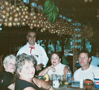 """Inviting your driver to eat with you is a GREAT way to pick their brain!  Guests Marge, Chris & Vicki from Sarasota, Florida with driver (after a LONG day of exploring) Frank Chicas enjoying a """"typico"""" Costa Rican meal!"""
