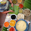 """Here's a GREAT description on the ART OF TAMALE MAKING<br /> SOURCE:  <a href=""""http://TicoTimes.net/Weekend/Restaurants/Tamale-making-with-Antojitos-de-Maiz_Thursday-June-13-2013"""">http://TicoTimes.net/Weekend/Restaurants/Tamale-making-with-Antojitos-de-Maiz_Thursday-June-13-2013</a> <br /> (GO TO THE SITE for a step-by-step WITH PICTURES guide on it!):<br /> <br /> If you're Costa Rican, then you have likely spent at least part of every Christmas season in the company of your entire extended family making tamales. The process can take days, but it ends with a a giant pot of banana wrapped tamales that last the whole Christmas season.<br /> <br /> For those lacking a Costa Rican grandmother or the patience to wait until December, there is Antojitos de Maíz, a restaurant in San Isidro de El General completely dedicated to corn.<br /> <br /> The restaurant's tamales are such a hit that local hotel Monte Azul has begun sending its guests over for cooking classes. So, with the illusion that we would soon be professional tamale chefs, two Tico Times reporters headed to Antojitos for a crash course in tamale-making. It turns out, that there is a good reason Costa Ricans only make tamales once a year. But if you happen to have hours of free time, there are few Tico dishes as delicious as homemade tamales.<br /> <br />  <br /> <br /> Step 1: Preparation and ingredients<br /> <br />  Making tamales is labor intensive, with each ingredient encompassing an entire meal in itself. To speed up the process, we were greeted in the Antojitos kitchen with bowls of pre-cut and pre-cooked ingredients, but to make your own tamales you first need to prepare the filling. We used a spicy chicken filling in our tamales, but there are other meat and vegetarian variations.<br /> Tamales 04<br /> <br /> We put chicken, carrots, cilantro, sweet chill and cheese in our tamales.<br /> Lindsay Fendt<br /> <br /> While you can fill your tamales with practically anything, traditional Costa Rican tama"""