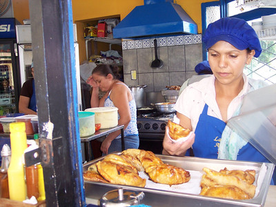 """I've heard they're famous for their genuine Argentinian EMPANADAS  ESQUINA ARGENTINA Restaurant   (2-288-2811)   A MEGA VIC'S PICK'S!!!   This is LITERALLY my #1 FAV """"Soda"""" (a """"soda"""" in Costa Rica is a little cheapo restaurant)!!!!  I LOVE LOVE LOVE THIS PLACE!!  MEGA CHEAP & AWESOME!!  FLAME GRILLED CASADAS (rice & beans or fresh mashed potatos and veges) - GRILLED beef, chicken, ribs, pork, fish (& sometimes tongue) & LOTS of DELISH CHIMICHURI SAUCE (parsley, olive oil, lemon, a tiny bit of vinegar, salt and LOTS of garlic!!) WITH a REALLY tasty salad PLUS a natural fresh fruit drink for 3,000-3,500-colones (around $6-$7).   MY fav is Costadas (ribs), mashed potatoes, veges, MUCHO MUCHO chimichuri sauce on EVERYTHING and Cass drink!!!!     CHEAP BREAKFASTS!  Dr. Gene McDonald always RAVED about their Lasagna on Wednesday.  A nice size piece for around 1,750-c.    They're quite the popular place so best to not be in a rush plus they can run out of things so get there early for your favorite choices.    HOURS:  Mon.-Fri. 7am-5pm-ish, Sat. & Sun. 7am-3:30pm-ish (but if it's slow they may close early)   STAFF:  Mari (owner), Carmen, Lucy (sorry, I can't remember the other girls names)  LOCATION:  Escazu (Centro) – 3 blocks East of the back of the church/1 block East of the old burned out Shell Gas Station (Bombo de Shell) on the East-bound road on the North side of the park – across the street from Panadaria Mundo.   NEW LOCATION!!!  I've heard they have a NEW LOCATION in Guachipelin - over by Blue Valley School!!  HOURS:  Monday-Friday 7am-5pm."""