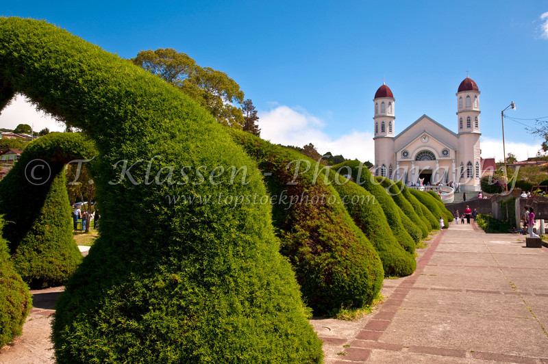 The San Rafael church with arched shrubs in Parque Francisco Alvarado, Zacero, Costa Rica, Central America.