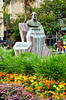 A sculpture and flower garden in a city square in San Jose, Costa Rica, Central America.