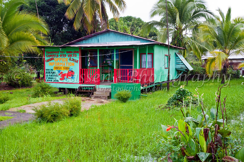 The pastel colored tourist office in Tortuguero, Costa Rica, Central America.