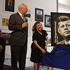 Lynn, Ma. 6-1-17. Tom Costin, left, watches as Mike Powers, the Distirct Manager of Greater Boston Postal District, unveils the new President Kennedy stamp with the help of Mayor Judith Flanagan Kennedy and Drew Russo at the Lynn Museum today.