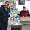 Cote's Market, on Salem Street in Lowell, is celebrating a century in business this year and is now in its fourth generation. David Gagnon, 45,  lives in the neighborhood and has been coming to the market for about 40 years. he was in on Friday to pick up a sandwich for lunch. Behind the register is owner Roger Levasseur. SUN/JOHN LOVE