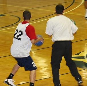 Basketball team playing dodge ball