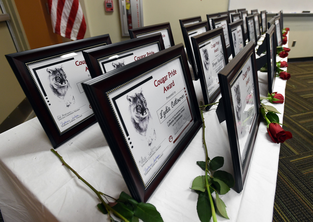 . Th e Cougar Awards ceremony was held at the Lafayette Public Library on Wednesday. The Cougar Pride Awards is an annual event, created by students a Lafayette Elementary,  to honor school retirees in the Lafayette area.  Cliff Grassmick  Staff Photographer May 17, 2017