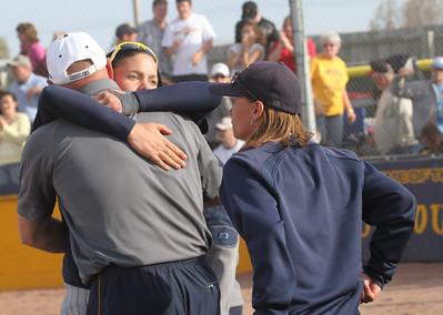 Softball team celebrating after winning title