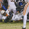 Emmanuel Muteberwa (22) of Fuquay-Varina falls forward for a first down. The Fuquay-Varina Bengals visited the Wake Forest Cougars in the 2nd round of the 4AA NCHSAA football championship playoffs played on Friday, November 23, 2018. Photo by Dean Strickland, O. D..