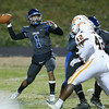 Mateo Sudipo (1) of Wake Forest throws a pass down the middle. The Fuquay-Varina Bengals visited the Wake Forest Cougars in the 2nd round of the 4AA NCHSAA football championship playoffs played on Friday, November 23, 2018. Photo by Dean Strickland, O. D..