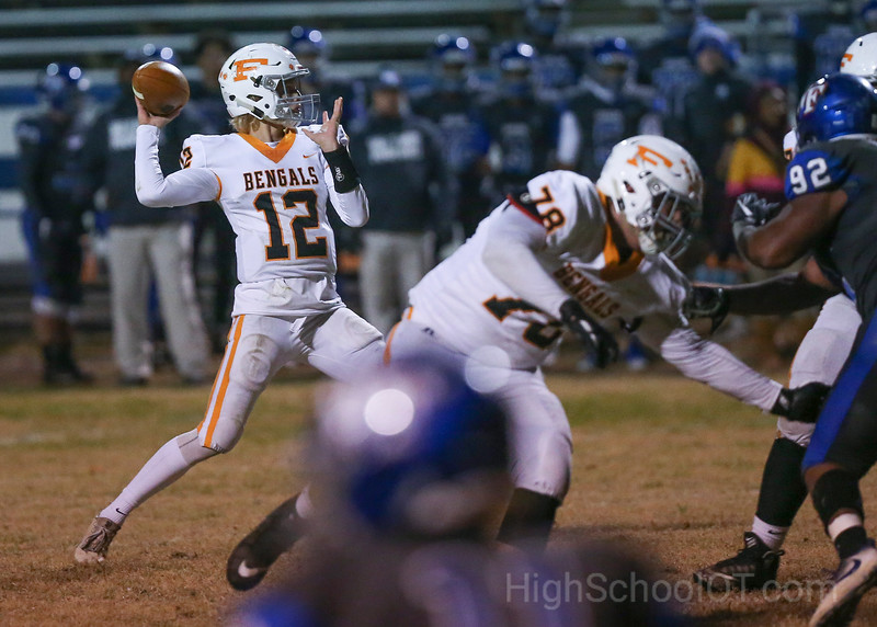 Lane Rhodes (12) of Fuquay-Varina looks for a receiver. The Fuquay-Varina Bengals visited the Wake Forest Cougars in the 2nd round of the 4AA NCHSAA football championship playoffs played on Friday, November 23, 2018. Photo by Dean Strickland, O. D..