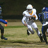 Matthew Lyons (11) of Fuquay-Varina  looks for an opening.The Fuquay-Varina Bengals visited the Wake Forest Cougars in the 2nd round of the 4AA NCHSAA football championship playoffs played on Friday, November 23, 2018. Photo by Dean Strickland, O. D..