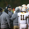 Fuquay-Varina head coach Jeb Hall (center) talks to his players during time out. The Fuquay-Varina Bengals visited the Wake Forest Cougars in the 2nd round of the 4AA NCHSAA football championship playoffs played on Friday, November 23, 2018. Photo by Dean Strickland, O. D..