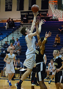Council Rock North senior Brady Haggerty (30) goes hard to the hoop.