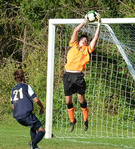 CR North goalkeeper Ed Mancinelli (00) goes high for great save.
