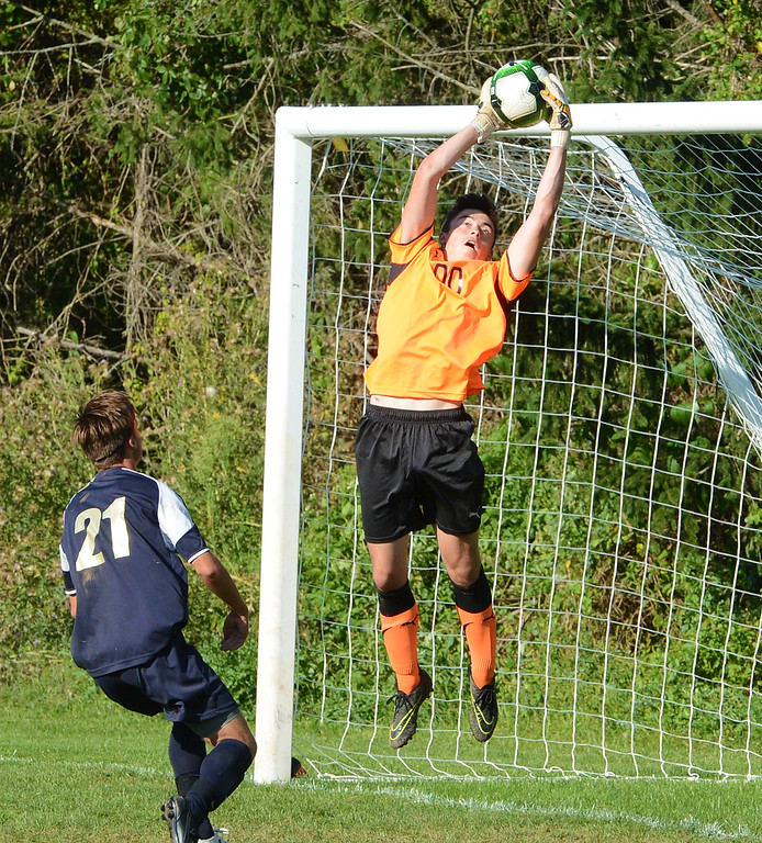 . CR North goalkeeper Ed Mancinelli (00) goes high for great save.