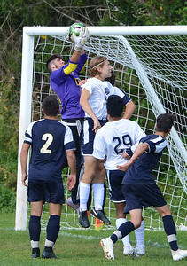 CR South GK Drew Bresnan (00) makes save over Branden Perry (18).
