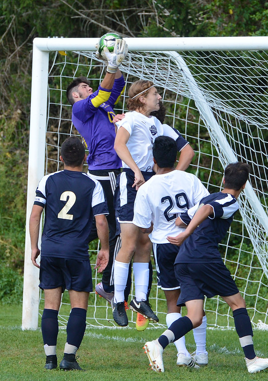 . CR South GK Drew Bresnan (00) makes save over Branden Perry (18).