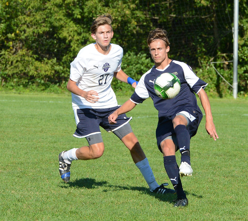 . South\'s Conor Sweeney (21) controls ball in front of Sean Finneyfrock (27).