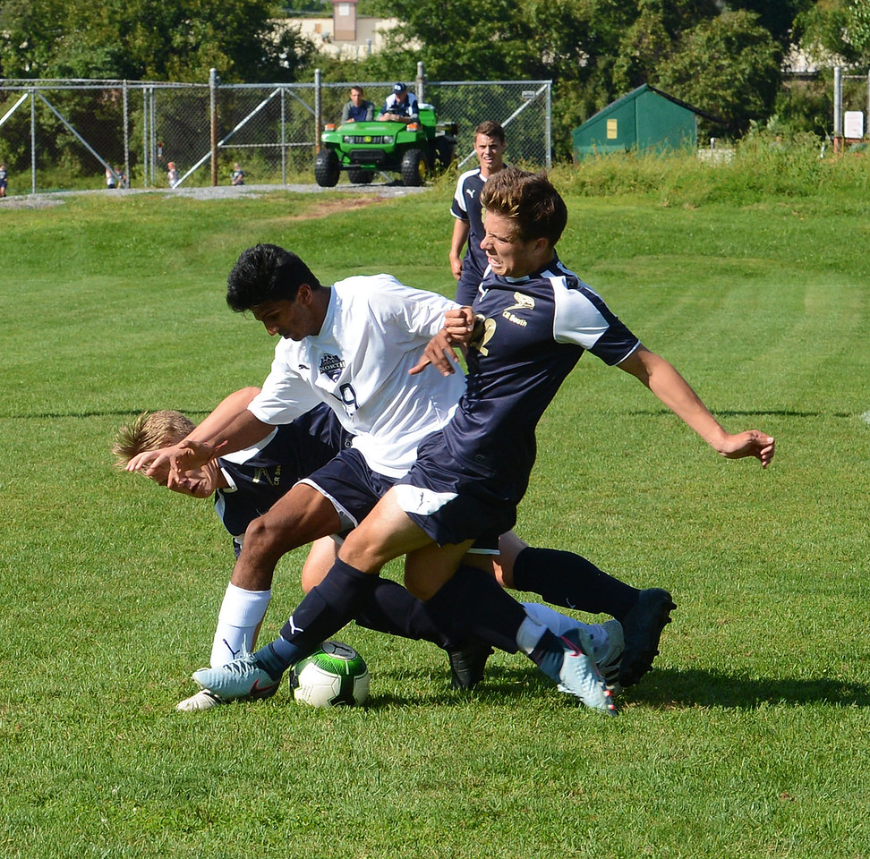 North's Akash Shah (29) battles for the ball with South's Dan Maggio (22).