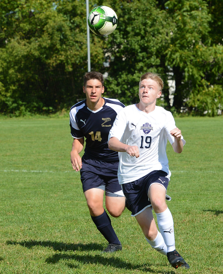 North's T.J. Grube (19) and Raphael Gersteyn (14) keep eyes on the ball.